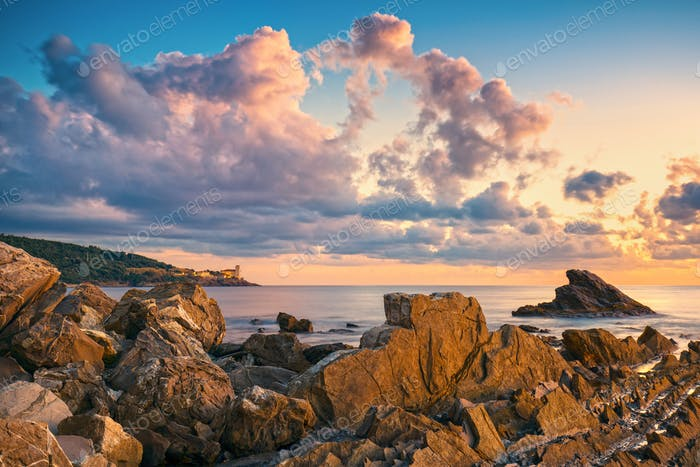 Rocks and buildings on the sea at sunset. Livorno, Tuscany rivie