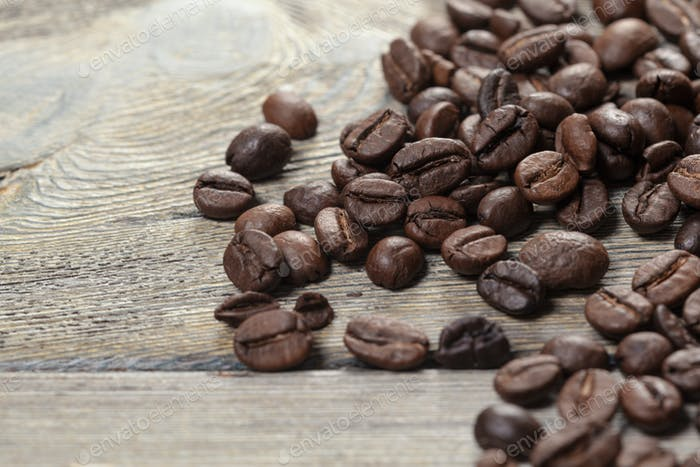Coffee beans on wood background. Creative Photo
