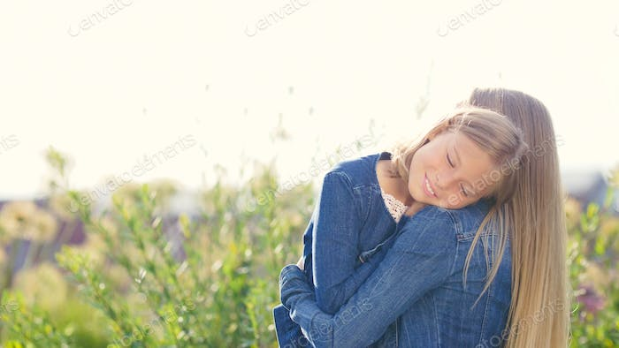 Hugging young family