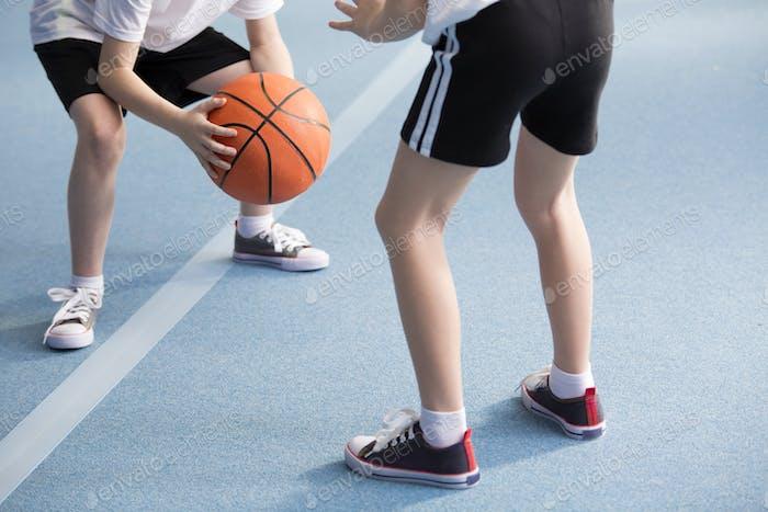 Pupils playing basketball