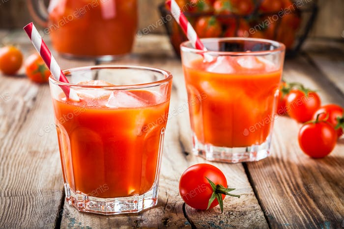 tomato juice with ice in glasses