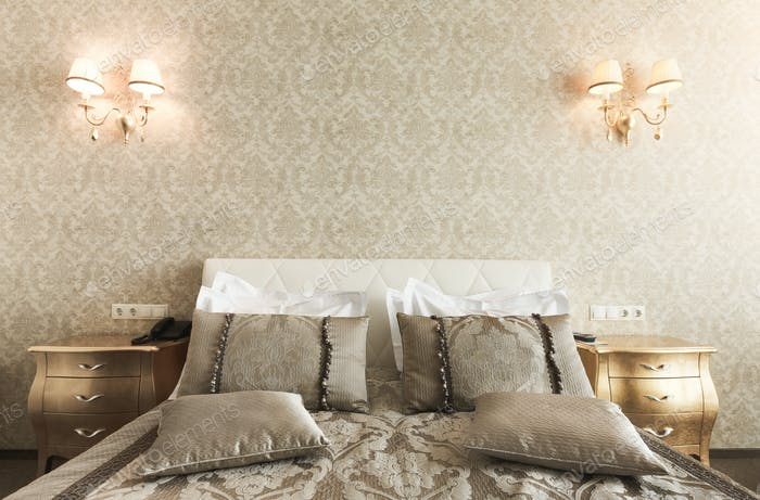 Interior of double bed hotel bedroom