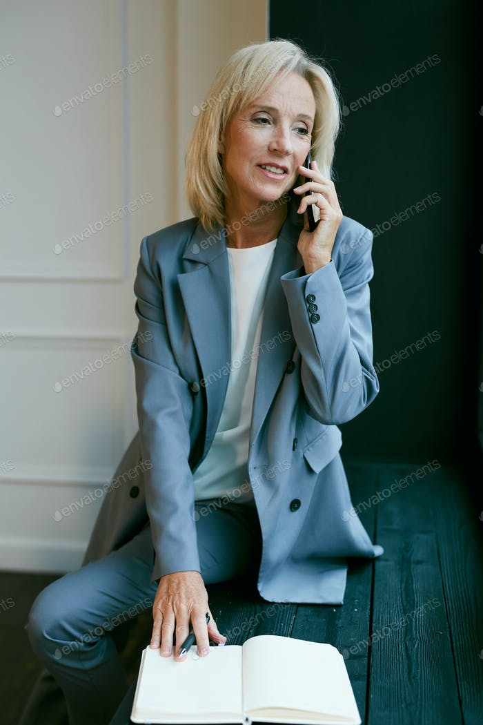 Smiling Mature Businesswoman Speaking by Phone