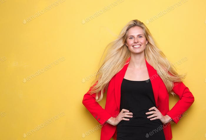 Young woman smiling in red jacket