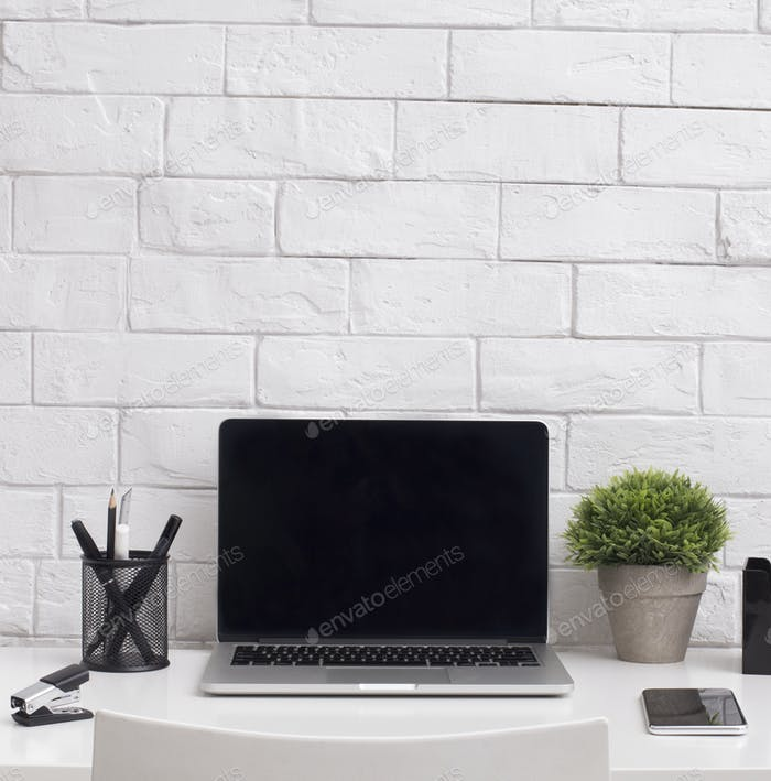 Close up of office laptop with blank screen for advertisement