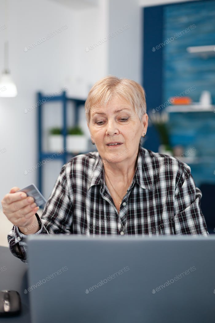 Middle aged woman checking bank account