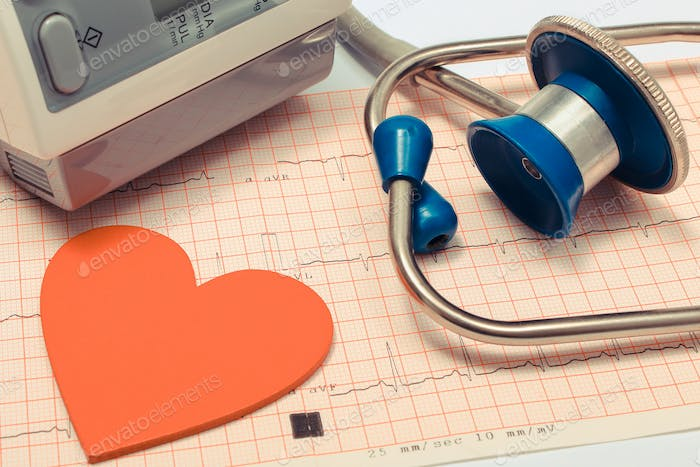 Medical stethoscope, heart shape and blood pressure monitor on electrocardiogram. Healthy lifestyles