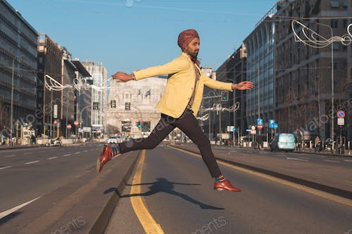 Indian handsome man jumping in an urban context