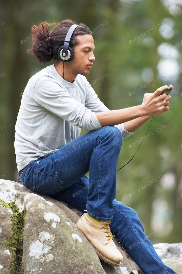 Man Listening To MP3 Player Whilst Hiking