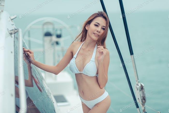 fashion outdoor summer photo of sexy girl with dark hair in luxurious bikini relaxing