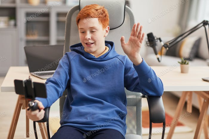 Red Haired Boy Video Blogging