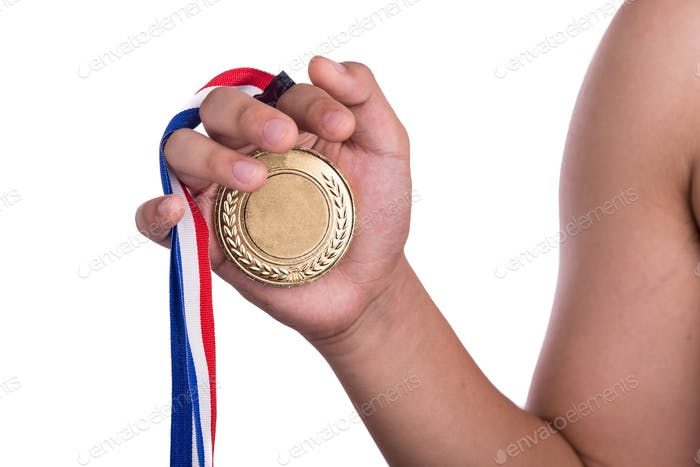 Athlete holding generic gold medal with ribbon on his hand
