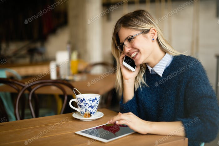Busy businesswoman drinking coffee