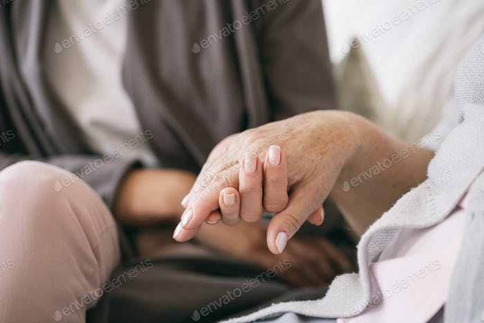 Caregiver holding the hand