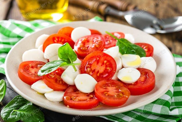 Tomato salad with mozzarella cheese and olive oil