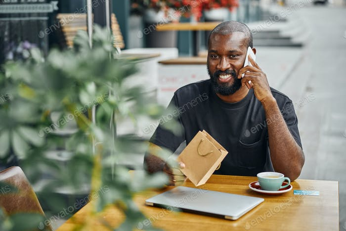 Man getting congratulations on the phone on birthday