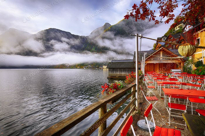 Scenic view of famous Hallstatter lake. Foggy autumn sunrise at
