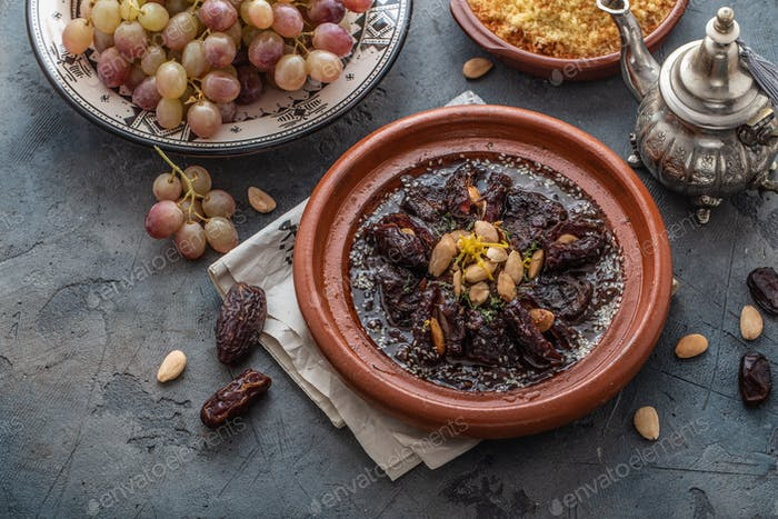 Slow cooked beef tajine with dates, raisins and almonds - moroccan cuisine, copy space