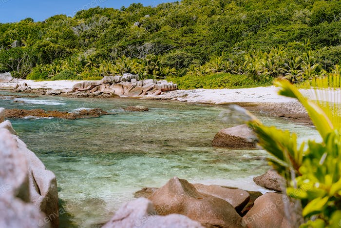 La Digue Island, Seychelles. Tropical beach with granite boulders - nature background