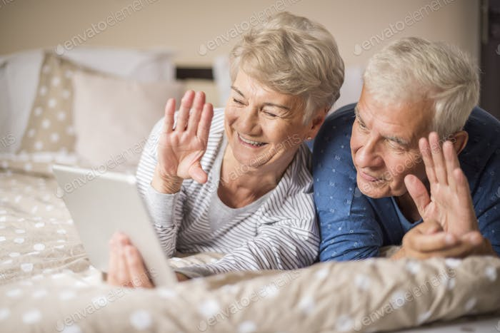 Senior marriage having a video conference