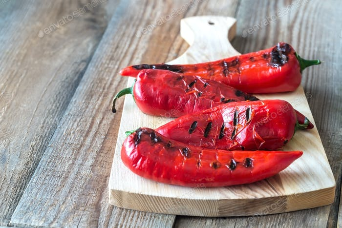 Grilled red peppers on the wooden board