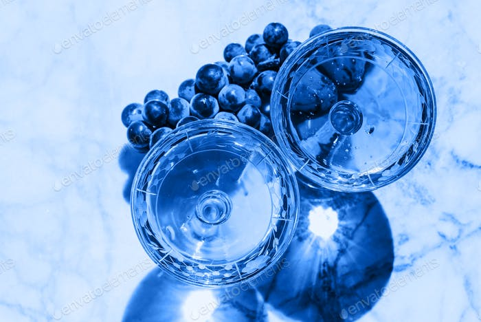 Two crystal stemmed glass with wine. Classic blue