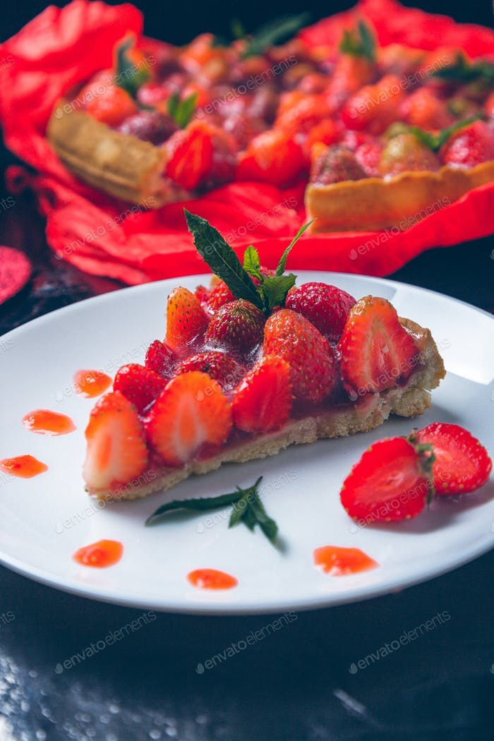 Strawberry pie on white plate.