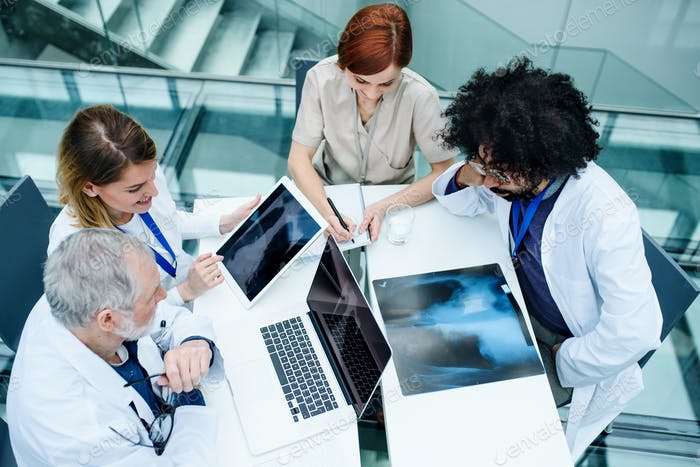 Group of doctors looking at X-ray on medical conference, discussing issues