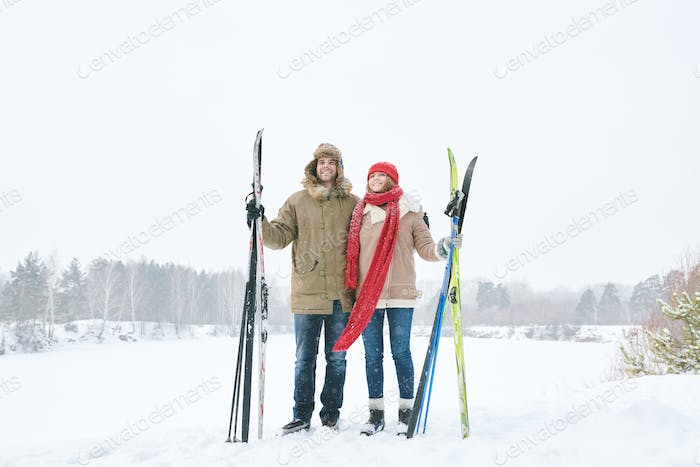 Active  Couple Holding Skis