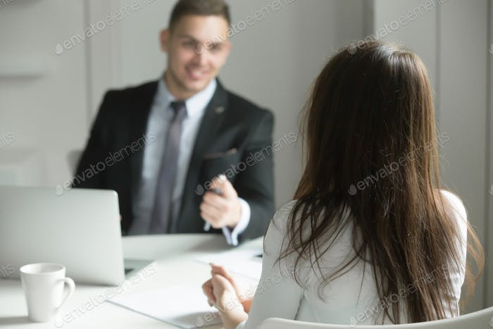 Two business people talking at the office desk