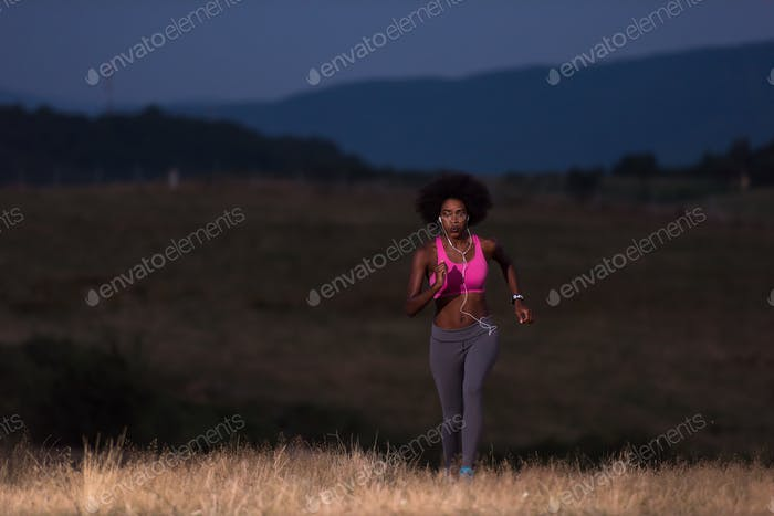 Thumbnail for Young African american woman jogging in nature