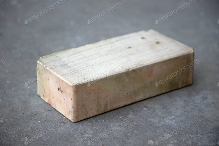old brick on grey concrete background