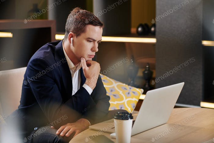 Pensive man checking e-mails