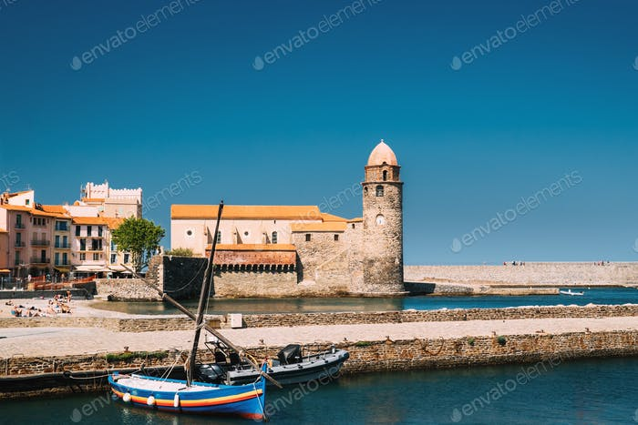 Collioure, France. Boats Moored On Berth Near The Church Of Our