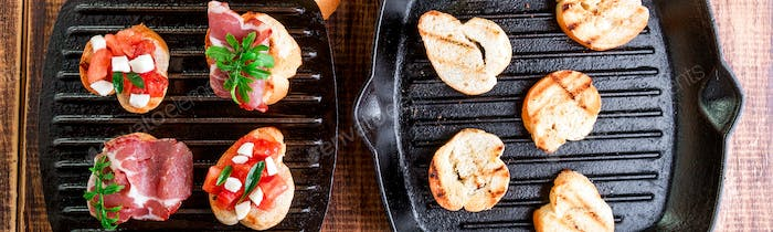 Banner of Toast on grill pan. Set of crostini