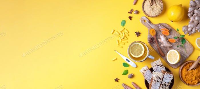 Medical care concept. Cold, flu treatment. Ginger, lemon, honey, pills, drugs, supplements