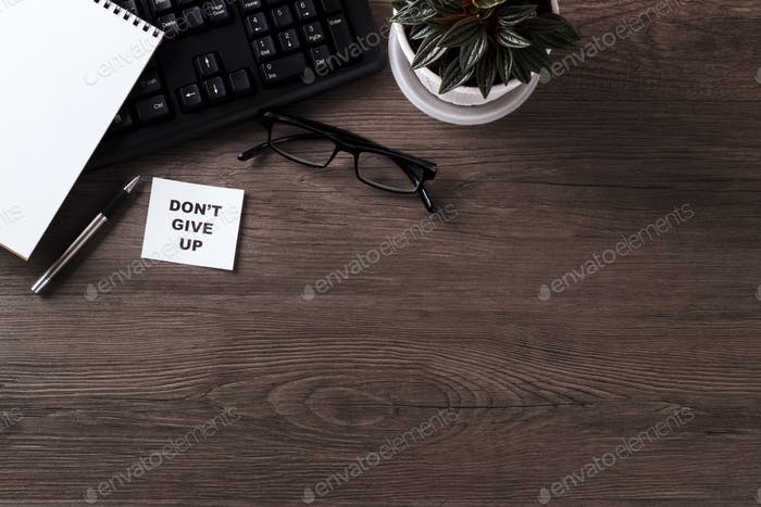 Modern office desk with motivation note