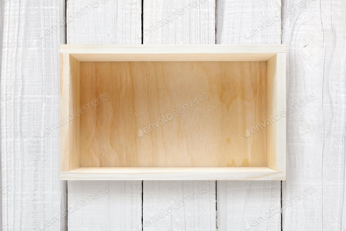 Wooden box on white wooden background