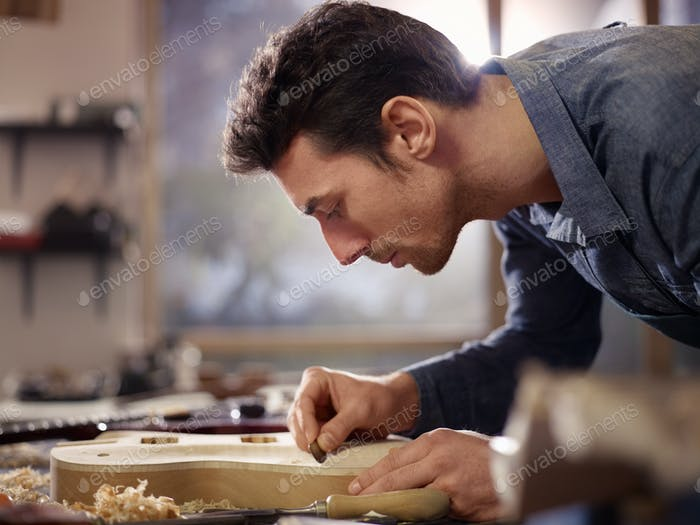 Italian Artisan Working In Lutemaker Workshop