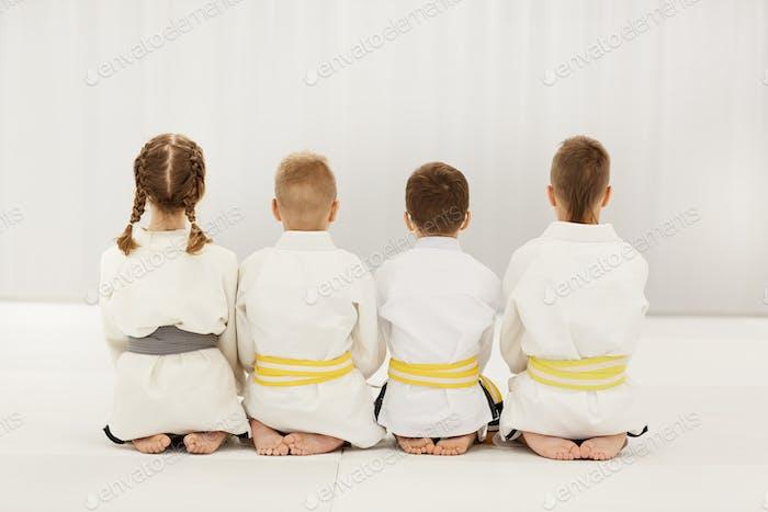 Children in kimono doing judo