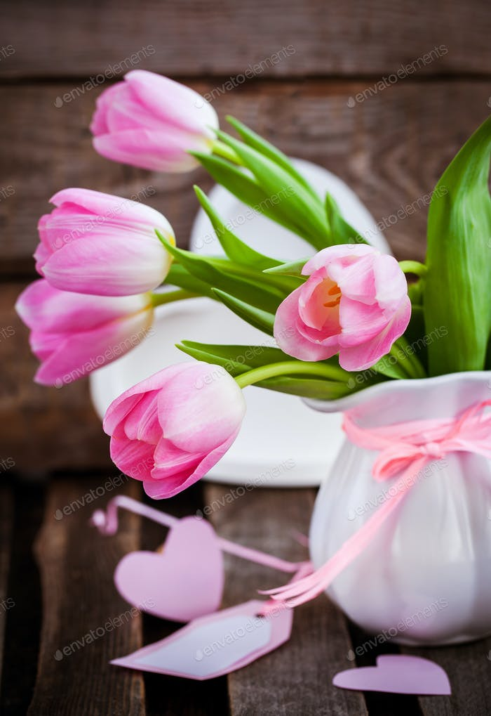 Fresh spring pink tulips with card and hearts