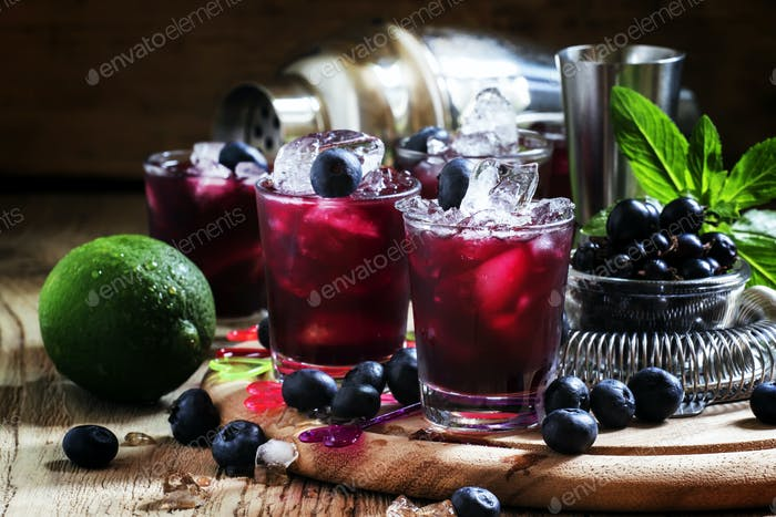 Alcoholic cocktail Darkside, with liqueur, blueberry, lime juice, crushed ice