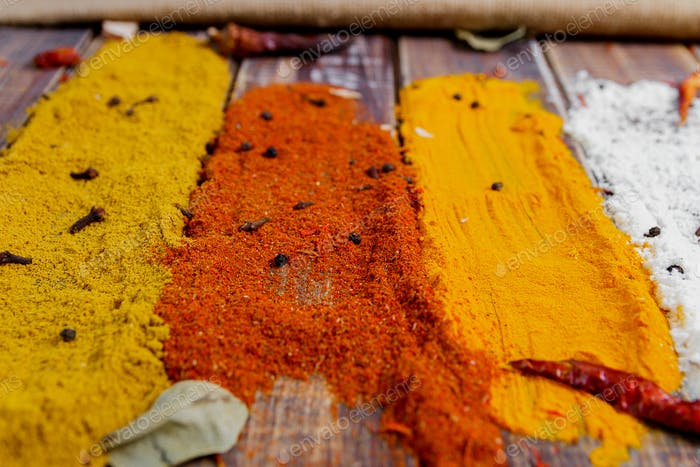 Colourful spices on the table. Various Spices in on wooden background. Spices background