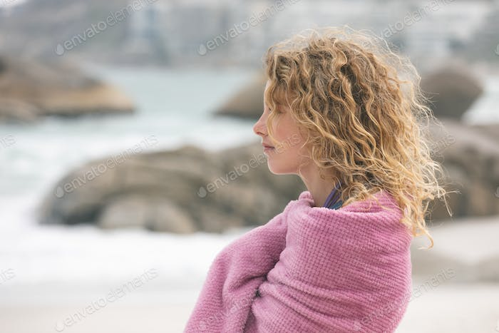 side view of caucasian woman standing on beach