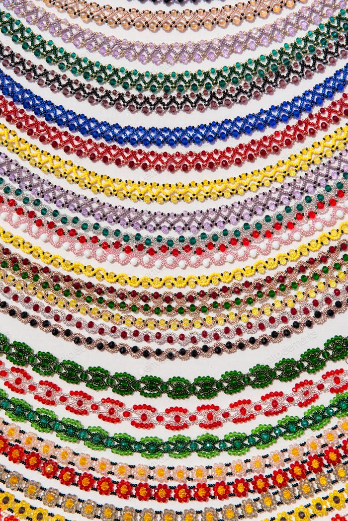 Background homemade of beaded necklaces made with traditional Romanian glass bead
