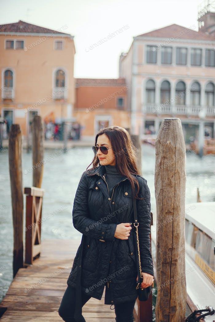 female tourist walking around and exploring venice