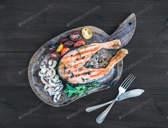 Grilledsalmon steak with fresh herbs, roasted mushrooms, cherry-