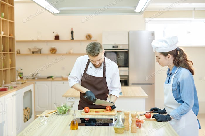 Two Professional Chefs Cooking in Restaurant