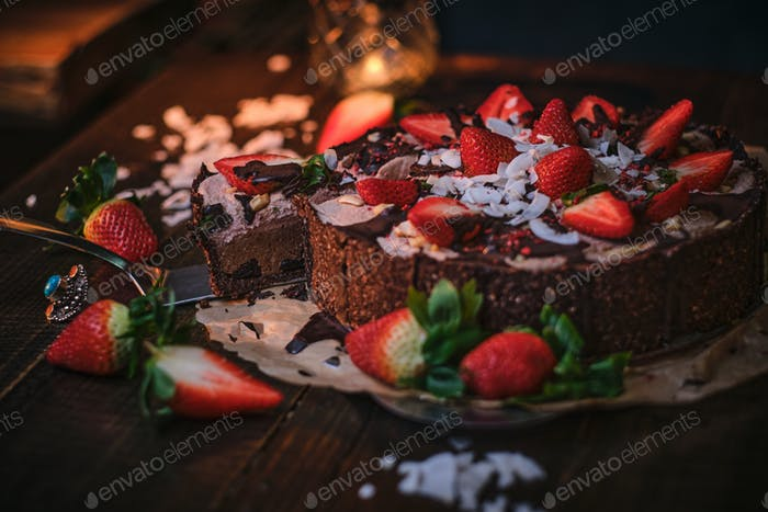 Vegan and delicious chocolate cake with strawberries on a paper serviette