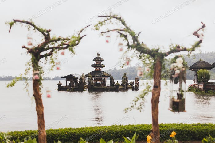 Wedding ceremony at Ulun Danu Bratan temple in Bali. Decorated with wood, flowers and vintage lamps
